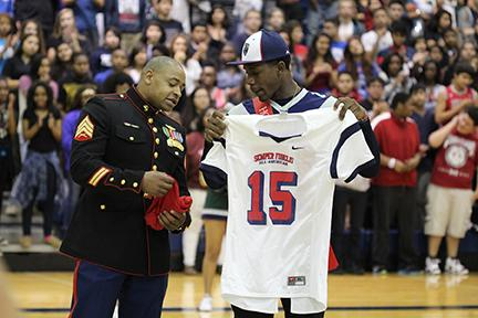 Cypress Ridge senior wide receiver Keham Siverand is presented with the Marine Corps Semper Fidelis All-American Bowl jersey during the Rams' pep rally on Oct. 17.