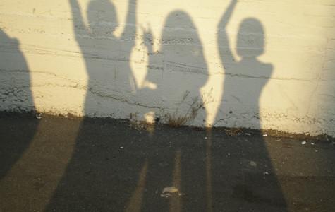 Shadow of teens on wall