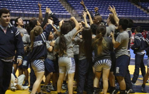 Cypress Ridge wrestling teams gets pumped before the UIL 6A District 10 championships hosted at the Berry Center.