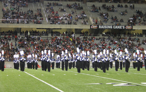 "The Cypress Ridge marching band and color guard performing ""The Aviary"" at the football game against Cy-Fair on Oct. 1, 2015. The band will perform again on Oct. 17 at 1:45 P.M."