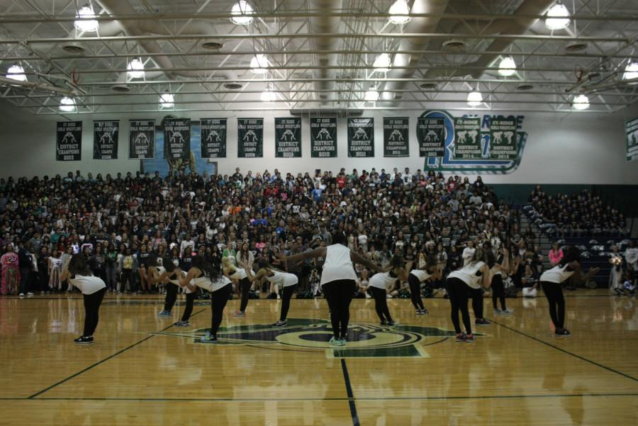 """Medina is the center of attention during the performance of hit single """"Hit the Quan"""" by iHeart Memphis during the Homecoming pep rally."""