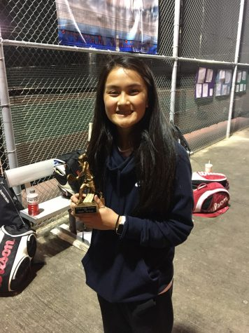 Kaitlyn Nguyen shows off her gold medal after tennis tournament.