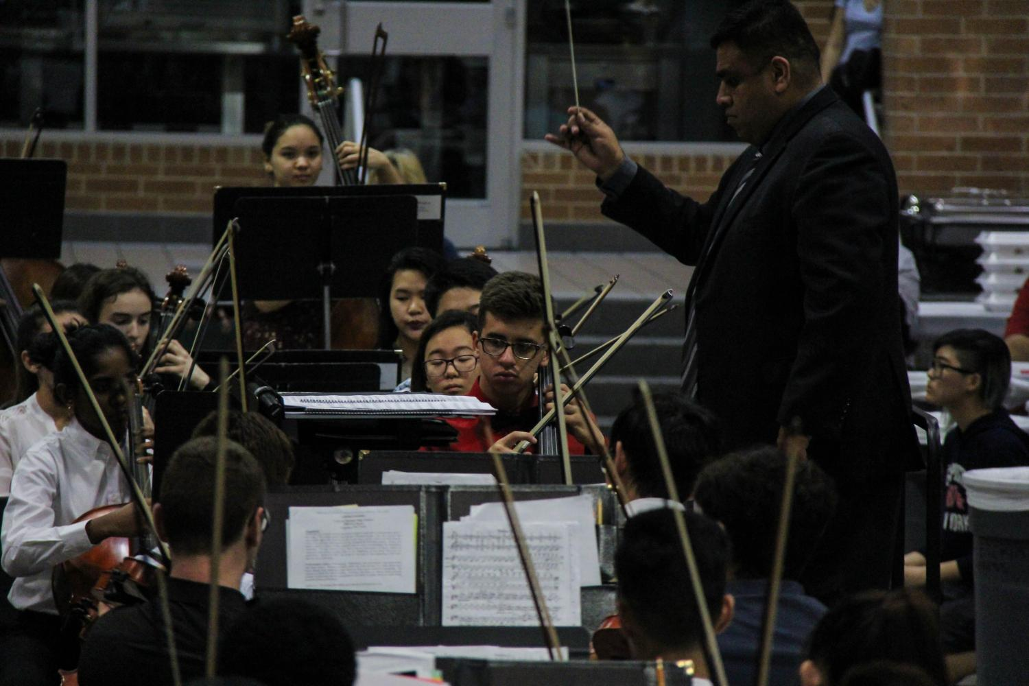 Director of Bands Armando Robledo conducts the Symphony Orchestra.