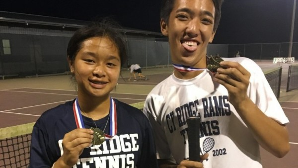 Players Michael Pham and Brittney Tran show off their gold medal after the tournament. Photo by: Terry Stanley