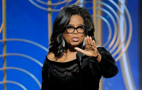 Oprah in the middle of giving her speech about the metoo movement