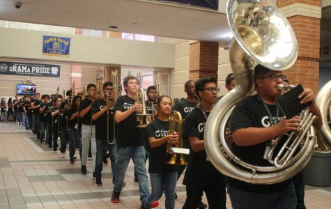 All the student musicians march down the halls on there way to perform at the 2017 annual pep rally.