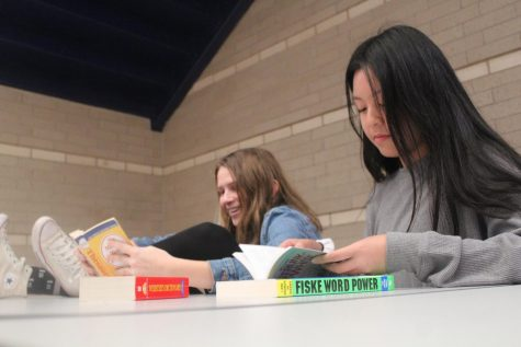 Macie Aschenbeck comfortably studies with her company Kaylynn Luong for their finals.