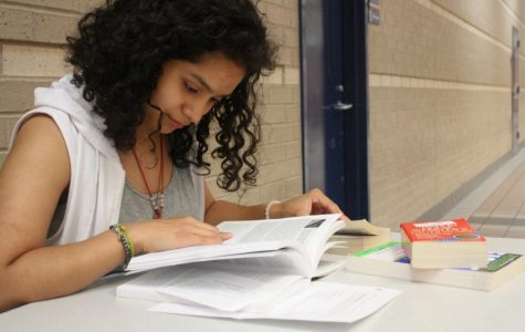 Junior Jimena Jimenez reads her textbook in order to acquire good grades in her classes