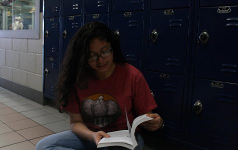 Junior Brianna Romo studies for her AP exams by reading textbooks.