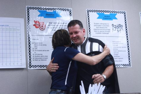 Principal Michelle and Dixon hugging it out once more.