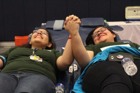 Seniors Carla Sanchez Duarte and Carolina Cavazos hold hands to support each other.